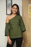 Pragya Jaiswal in a single Sleeves Off Shoulder Green Top Black Leggings promoting JJN Movie at Radio City 10.08.2017 067.JPG