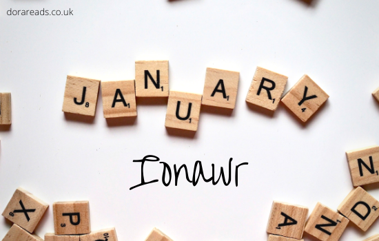 'January' spelled out in scrabble tiles, with 'Ionawr' written beneath it