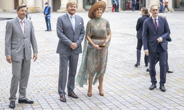 Queen Maxima wore a floral print dress from spring summer 2020 collection of Natan. Gold diamond earrings from Ole Lynggaard