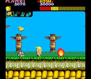 Captura de pantalla que muestra a Wonder Boy a punto saltar una hoguera