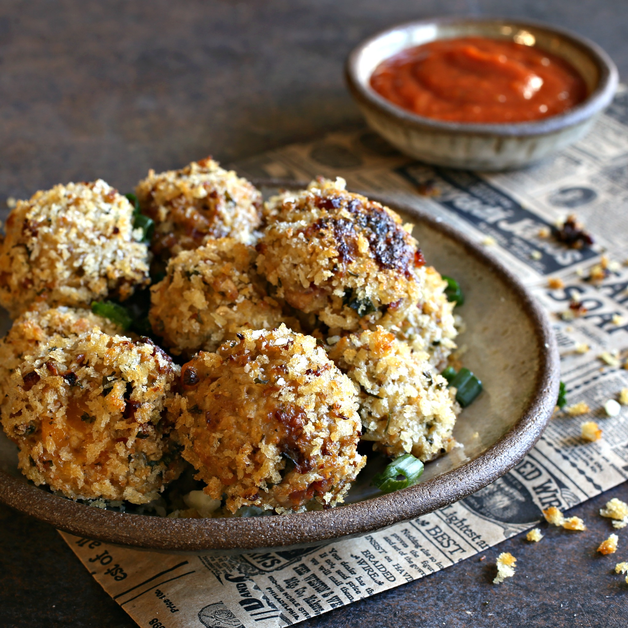Recipe for baked rice balls made with cauliflower rice, bacon and a cheesy cheddar center.