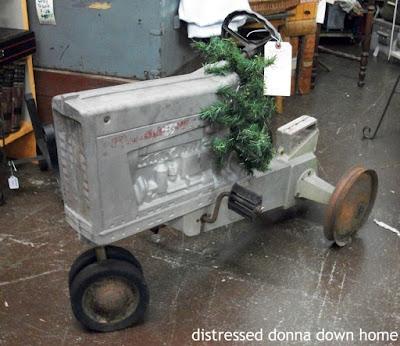 Ertl pedal tractor, German bisque snow babies, Architectural salvage, phone niche