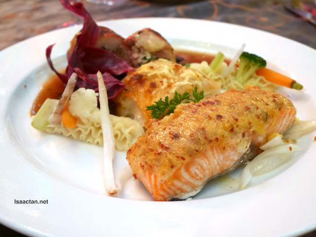 Combination of Oven baked Salmon with Garlic Paste and Chicken Roulade