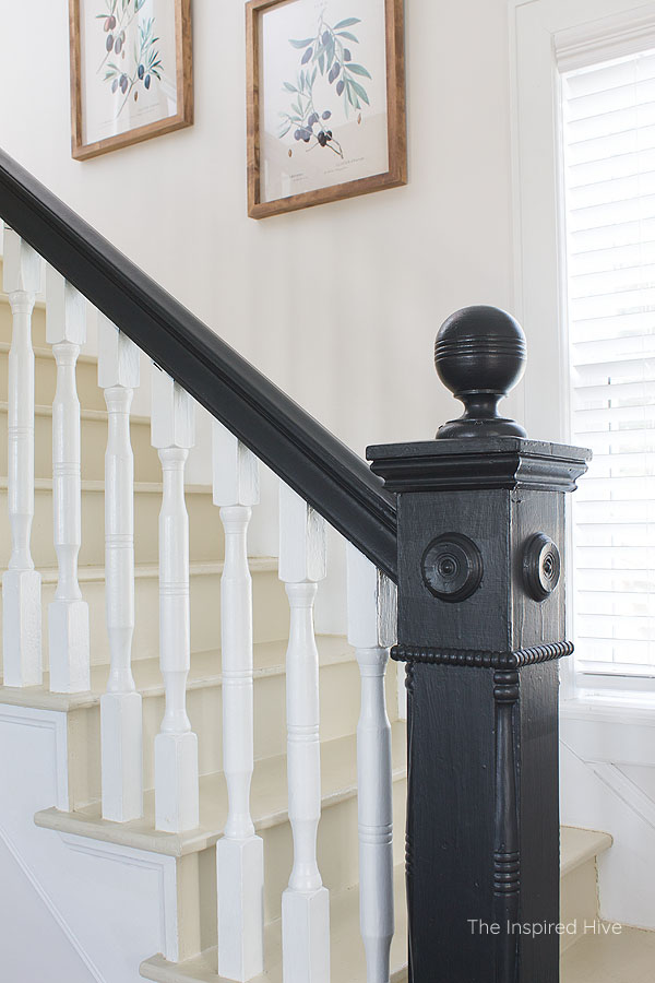 Black painted gothic revival newel post in 100 year old farmhouse