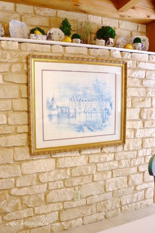 stone-wall-shelf-blue-white-dishes-fall-style