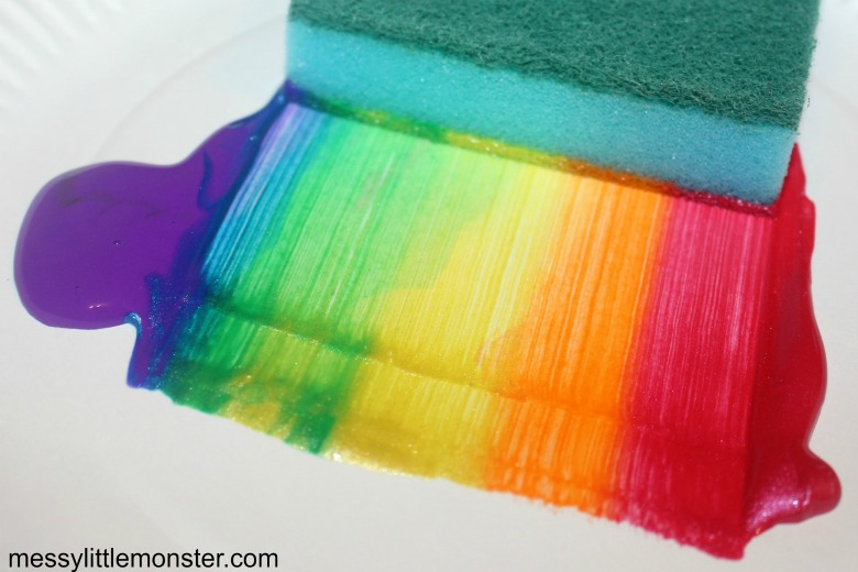 Painting a rainbow activity for toddlers and preschoolers.