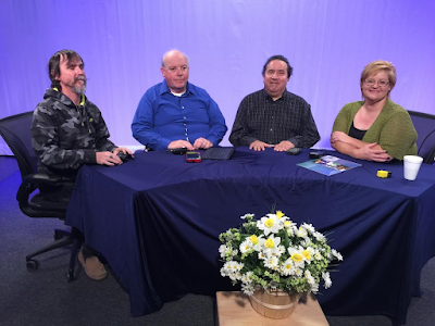 Guests from left to right; Tom Randall, William Elliott, Nathan Romo, sit behind a desk topped by a blue table cloth. Darcie Elliott Host sits to far right on this sixth edition of Blindside Fresno