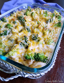 casserole dish filled with egg noodles, broccoli, cheese and chicken baked into a delicious casserole