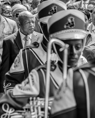 photo of John Lewis with marching band