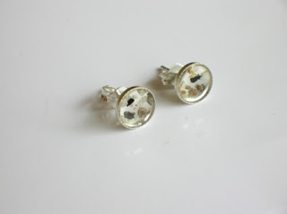 Sterling silver circular ear-studs containing ashes