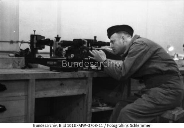 Soldier testing a telescope in France, 14 March 1942 worldwartwo.filminspector.com