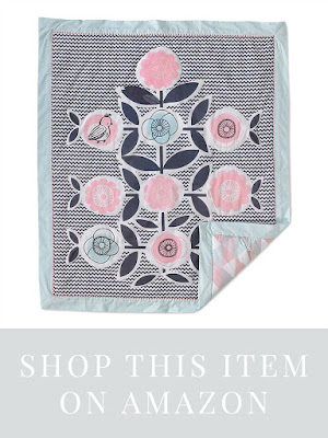 Cute bohemian style baby quilt for baby girl's nursery bedding. Featuring birds and pink flowers.
