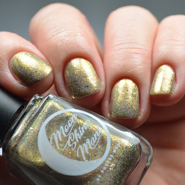 holographic champagne nail polish swatch in low light