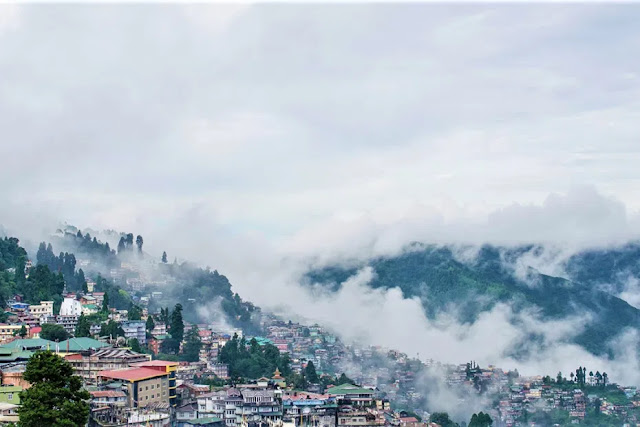 spectacular view of Darjeeling city with cloudy sky and fog