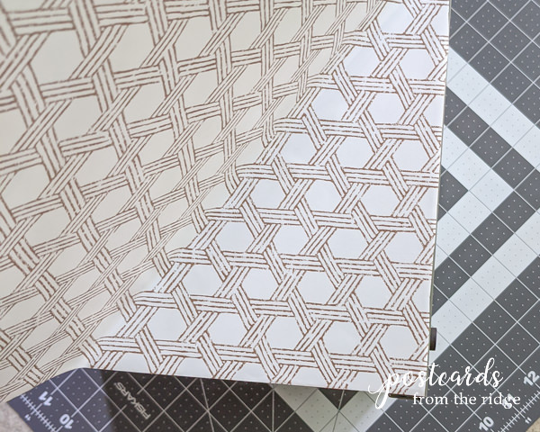 removable adhesive easy liner being added to vintage metal paper organizer