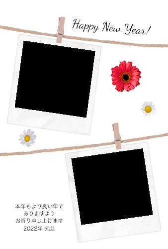 吊るされた2枚のポラロイド写真フレーム付きのガーリー年賀状