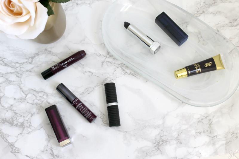 dark lipsticks on a marble table