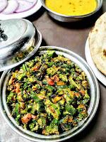 Serving bhindi ki sabji bhindi fry with dal and roti