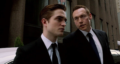 Eric Packer (played by Robert Pattinson) with his security-in-chief/bodyguard
