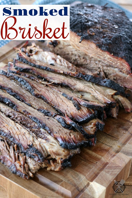 Smoked brisket on a cutting board sliced thin
