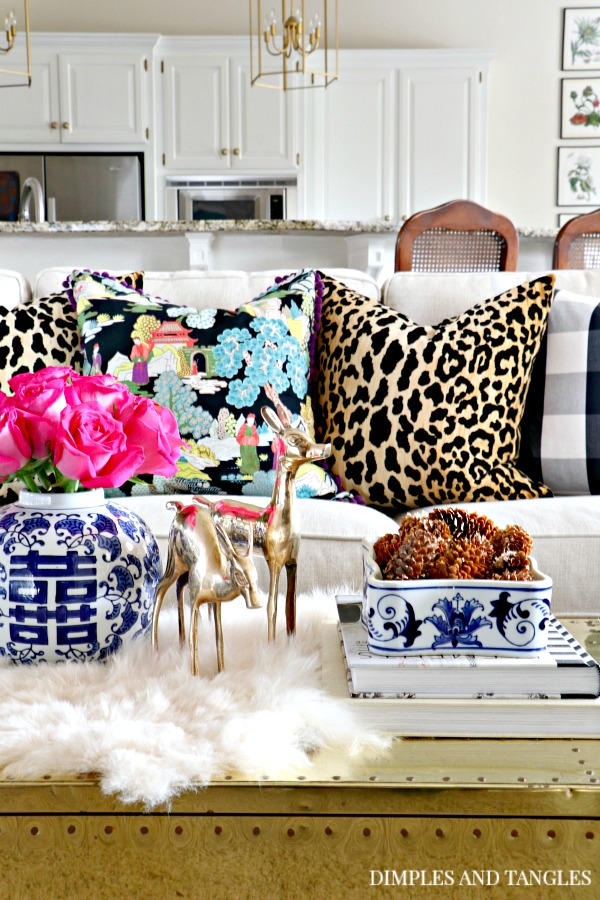 neutral sofa, fall home tour, fall decorations, buffalo check pillow, jamil leopard pillow, brass trunk, blue and white