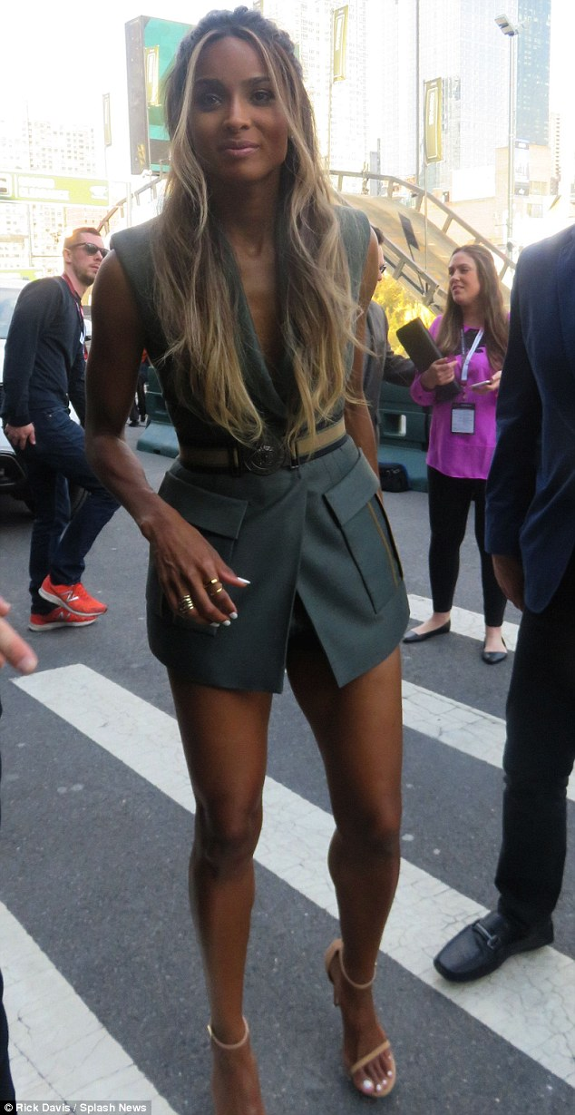 Newly-engaged Ciara shows off long legs in plunging Versace vest and short shorts 2
