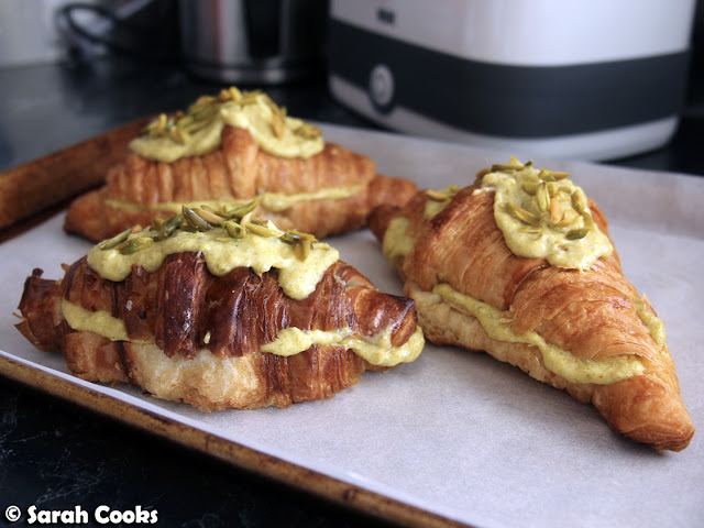 Filled and topped pistachio croissants