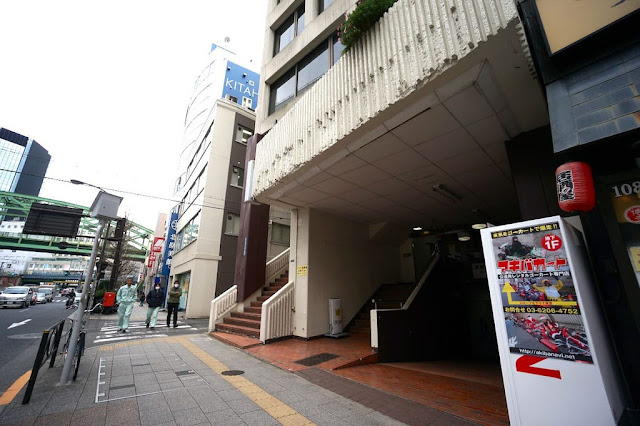 Guests walking the sidewalk to the entrance of Crown, a cosplay and photo shoot shop in Akihabara district