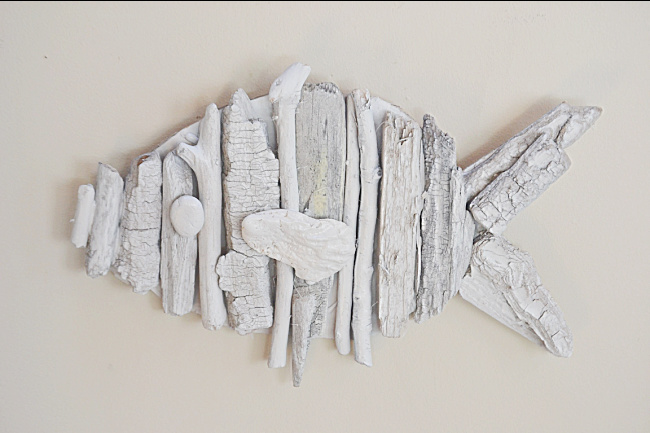 white driftwood fish hanging on the wall