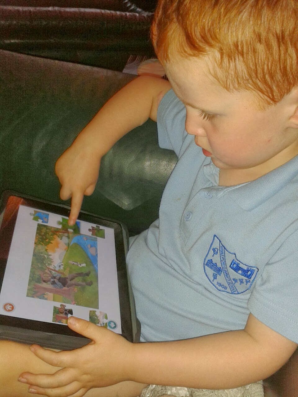 Ieuan playing with iPad