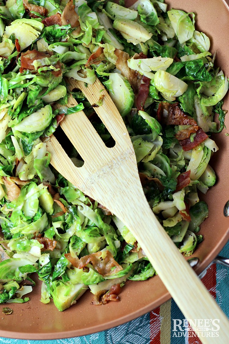 Overhead view of Sauteed Brussels Sprouts with Bacon by Renee's Kitchen Adventures in pan with wooden spatula image
