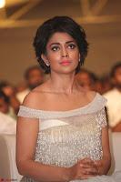 Shriya Saran in Stunning White Off Shoulder Gown at Nakshatram music launch ~  Exclusive (64).JPG