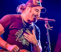 Wetzel was born in the East Texas town of Pittsburg on July 14, 1992. He picked up his interest in music from his mother, who was a singer and brought young Koe on the road with her