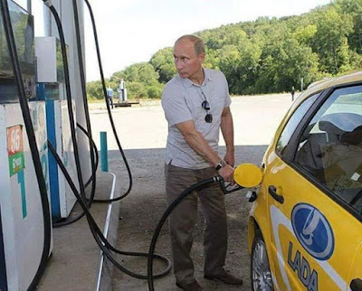 Russian President Vladimir Putin Seen Getting Fuel Himself At Filling Station