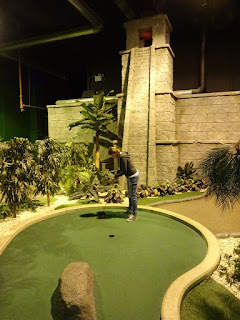 Emily playing at Paradise Island Adventure Golf in the Trafford Centre, Manchester