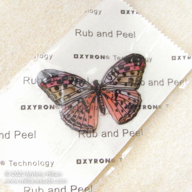 Resined butterfly on Xyron Sticker Maker backing paper