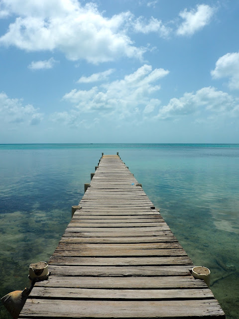 Pier stretching into the ocean around Caye Caulker, Belize