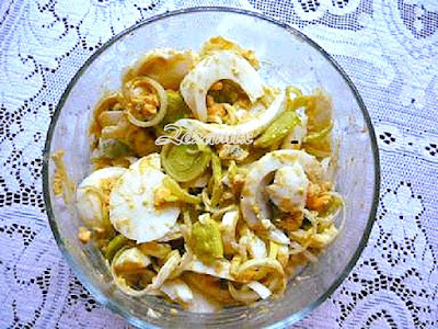 salad of boiled eggs and fresh leeks