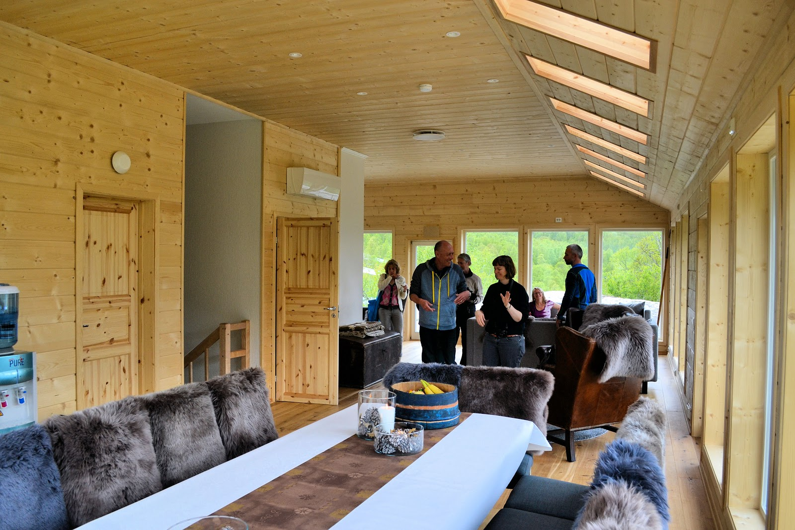Interior of the Wolf Lodge inside the wolf enclosure. Bedrooms and full bath downstairs while the kitchen, dining and gathering areas are on the second level with floor-to-ceiling windows for peering out into the wilderness.