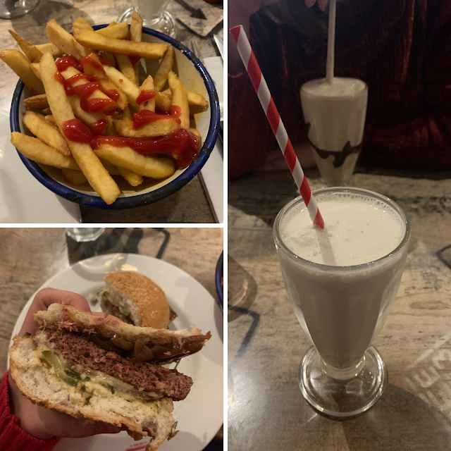 Top left photo is a bowl of chips topped with ketchup, bottom left is a burger. Main photo is a glass with milkshake