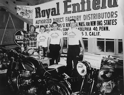 Photo of motorcycles and young men in Royal Enfield T-shirts.