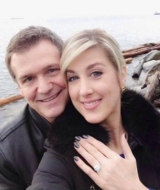 Anne Drewa showing her engagement ring while clicking selfie with her boyfriend