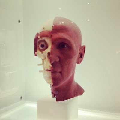 humanoid robot face with half its skin peeled off