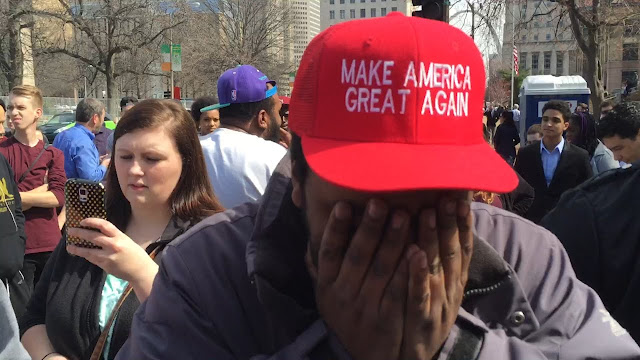 Trump supporter in the middle of a protesting crowd!