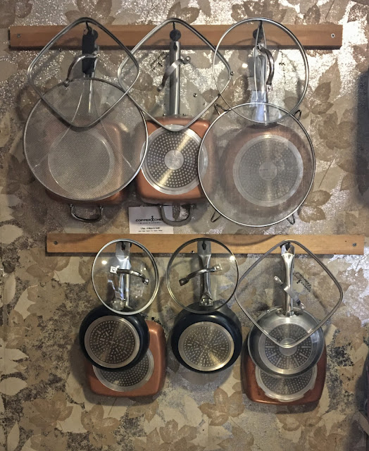 Homemade wall-mounted rack for storing pots, pans and lids