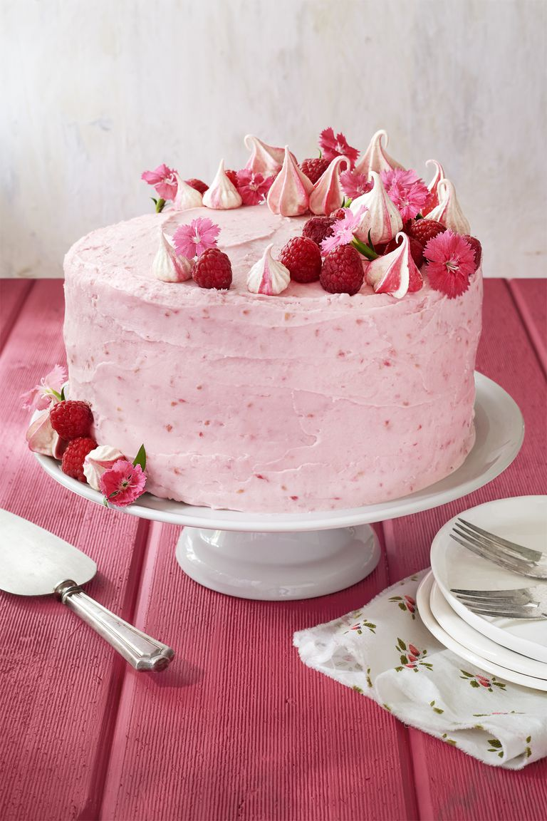 Raspberry Pink Velvet Cake with Raspberry Cream Cheese Frosting - Topped with fluffy meringues and edible flowers, this pretty-in-pink raspberry velvet cake is about as springy as it gets.