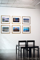 Cramer Imaging's photograph of six framed landscape photographs from the Grand Teton Council Collection on a gallery wall