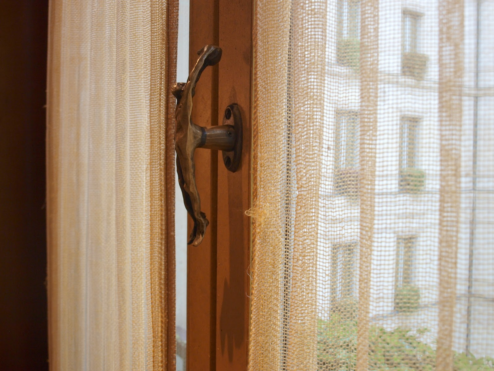 Detail of French window and Rosaline Granet hardware in suite at Park Hyatt Paris by Hello Lovely Studio