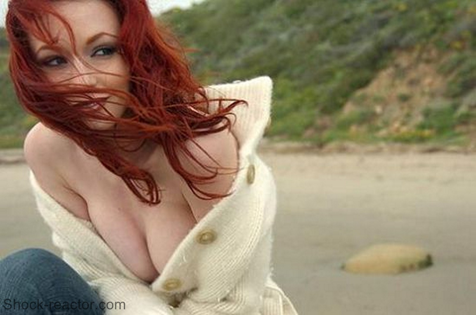 This hot redhead is using two vibrators 1