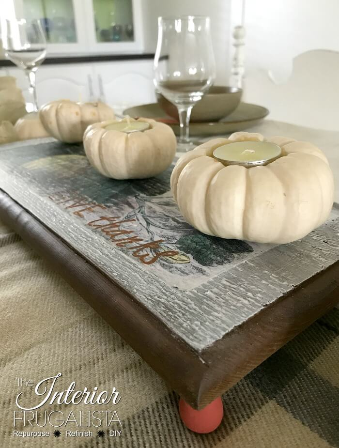 A simple wood table riser with farmhouse-style made with scrap wood and a vintage pumpkin graphic for Fall decor. Without feet it's a cute Fall sign!